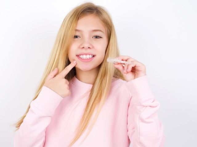 Beautiful,Caucasian,Little,Girl,Wearing,Pink,Sweater,Over,White,Background